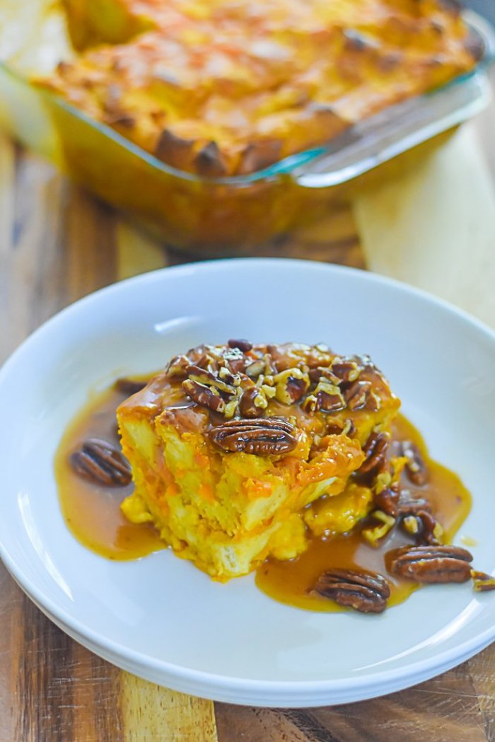 piece of sweet potato bread pudding with praline sauce and pecans.