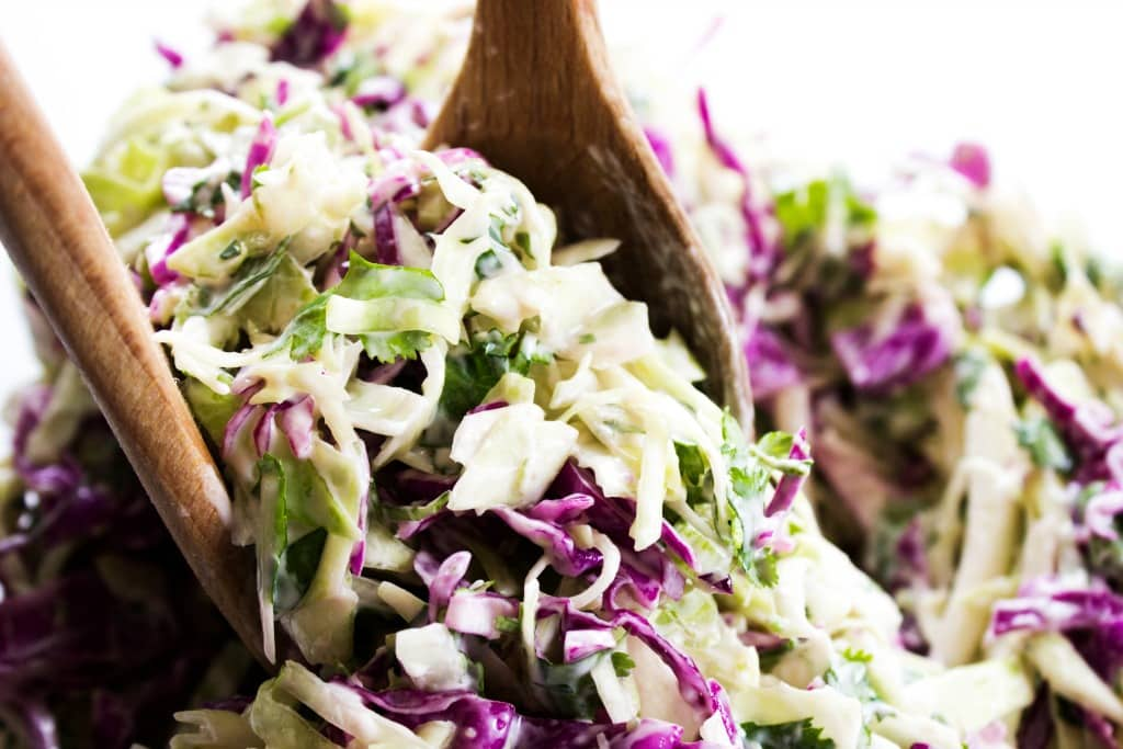 CILANTRO LIME COLESLAW Wooden serving spoons
