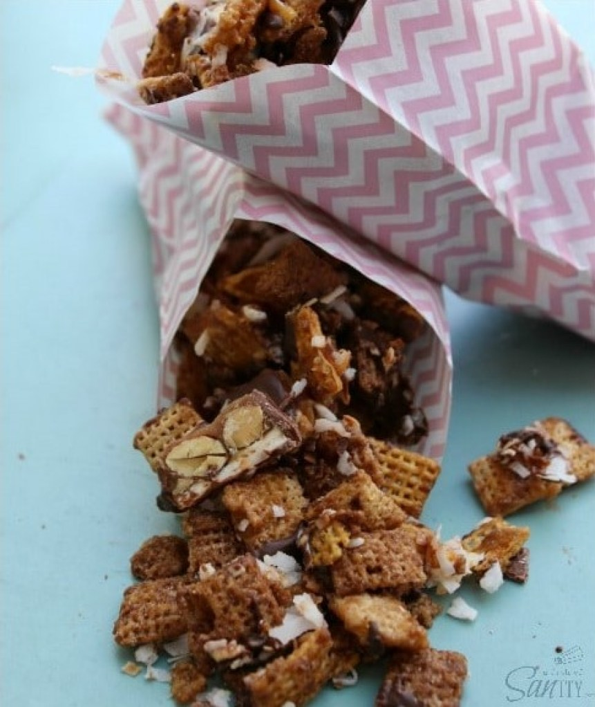 This Sweet & Salty Caramel Snack Mix is made with caramel, SNICKERS®, toasted coconut, chocolate & more caramel. This snack is seriously addicting.