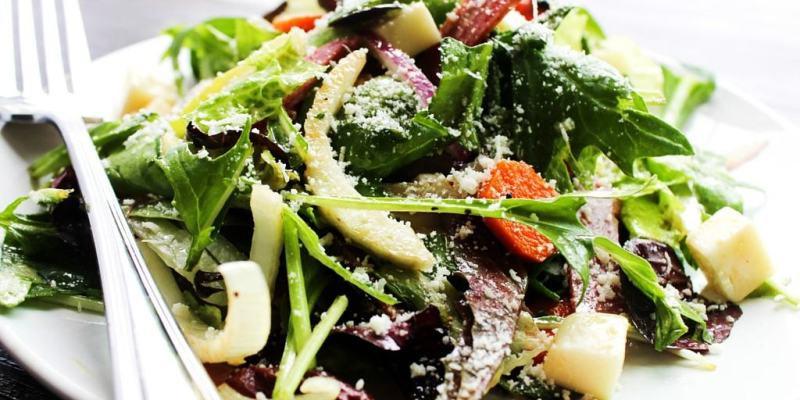 Copycat Carrabba's Chopped Salad is filled with flavors, textures, and a pop of color from the salami and kalamata olives. This salad is perfect for summer.