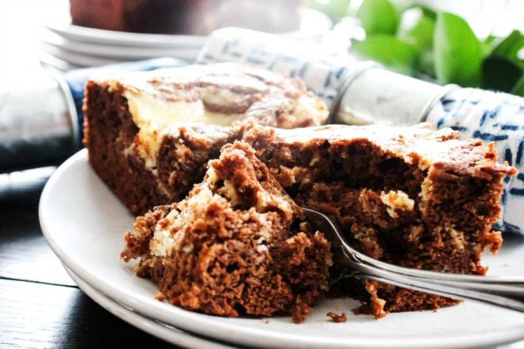 This Chocolate Pumpkin Cream Cheese Swirled Coffee Cake is gorgeous yet very simple. It is a perfect breakfast or even dessert for the holiday season.