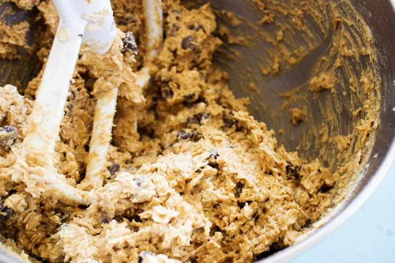 CHEWY OATMEAL PEANUT BUTTER CHOCOLATE CHIP COOKIES -  Cookie dough in metal mixing bowl
