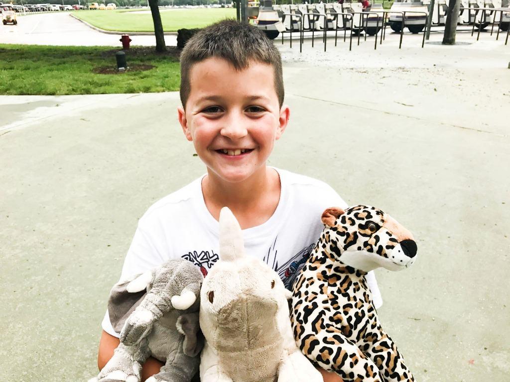 BEST EVER LEMONADE – Madden holding stuffed animals