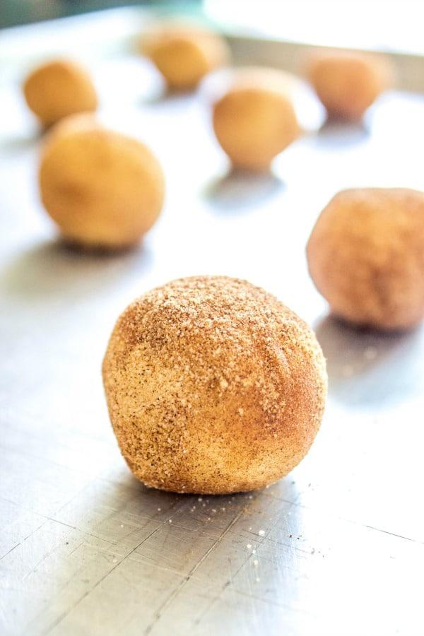 BEST EVER SNICKERDOODLE COOKIE RECIPE - Cookie dough in balls on metal cookie sheet