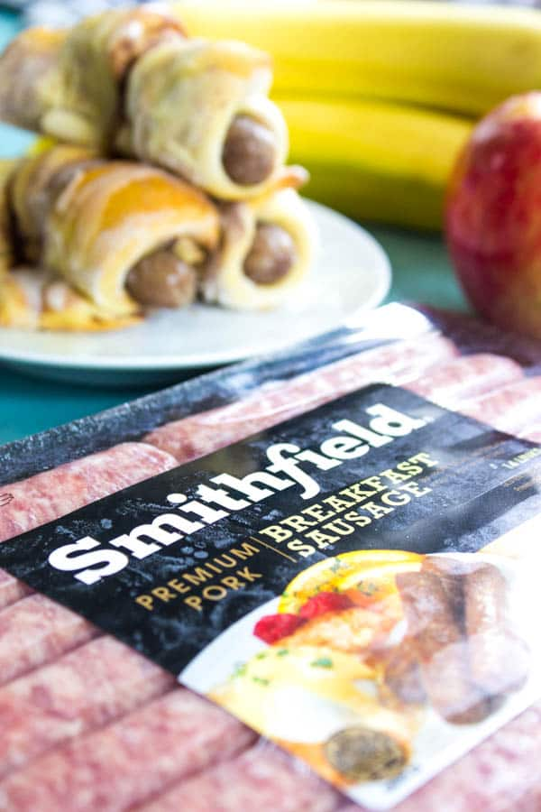 """BREAKFAST PIGS IN A BLANKET - a cinnamon roll wrapped around a breakfast sausage link. There isn't a more delicious way to eat """"pigs in a blanket""""."""
