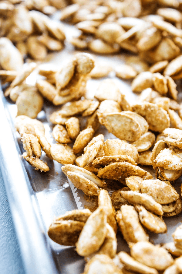 CINNAMON SUGAR PUMPKIN SEEDS are roasted to perfection and is now my favorite Halloween snack.