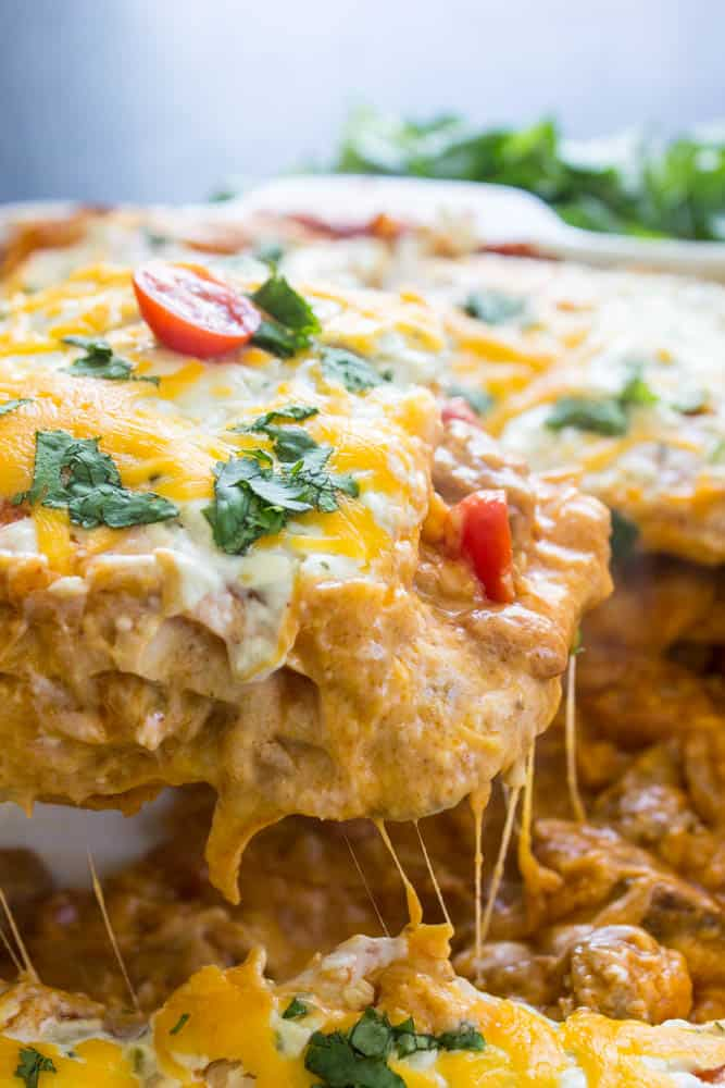 STEAK AND QUESO ENCHILADA CASSEROLE – an easy dinner for the holidays and great for gatherings. This cheesy casserole is baked to perfection.