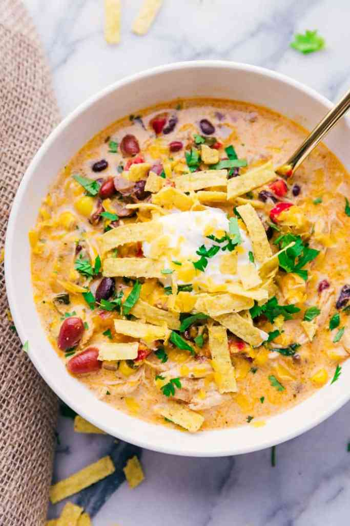 Chicken Tortilla Soup bowl with spoon and garnishes