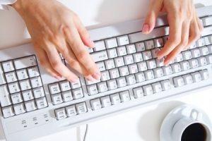 Woman's hands at computer