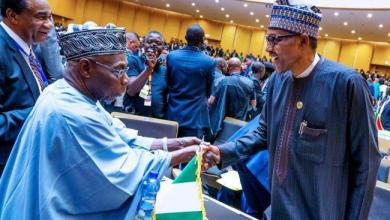 Photo of Buhari, Obasanjo meet at AU summit