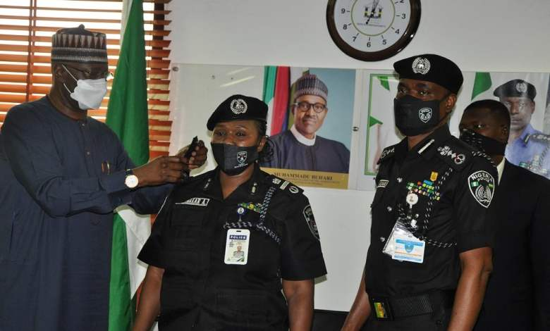 AIG Aishatu Abubakar (centre) being decorated with her new rank by SGF Boss Mustapha and IGP Mohammed Abubakar
