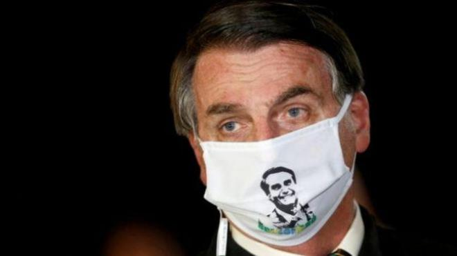 """President Bolsonaro has in the past said that he """"won't be struck down by a little flu"""" (Photo: Reuters)"""