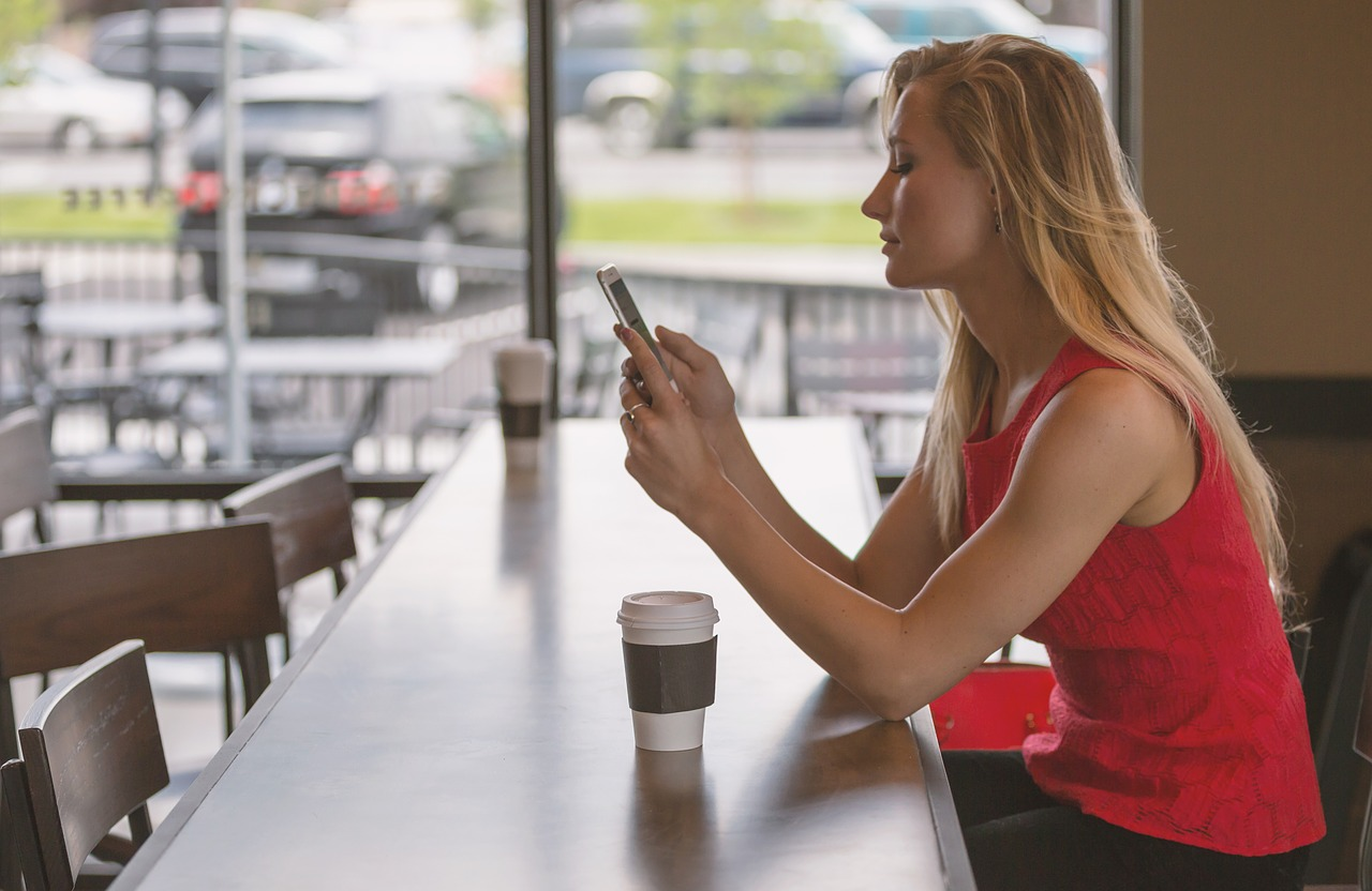 No Contact Rule - Woman with coffee Using Phone