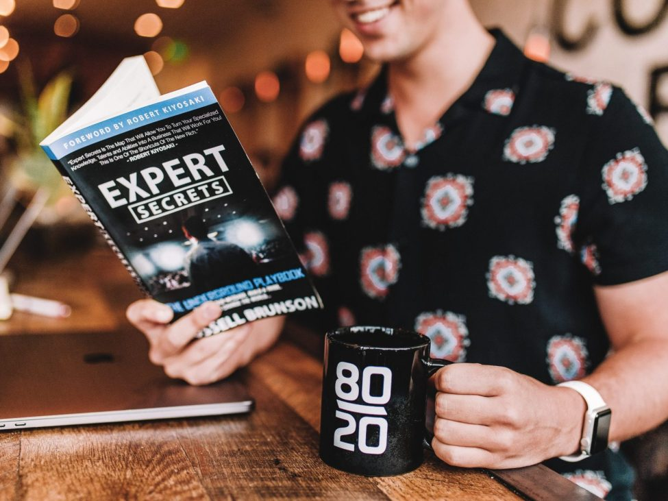 Man reading book about experts