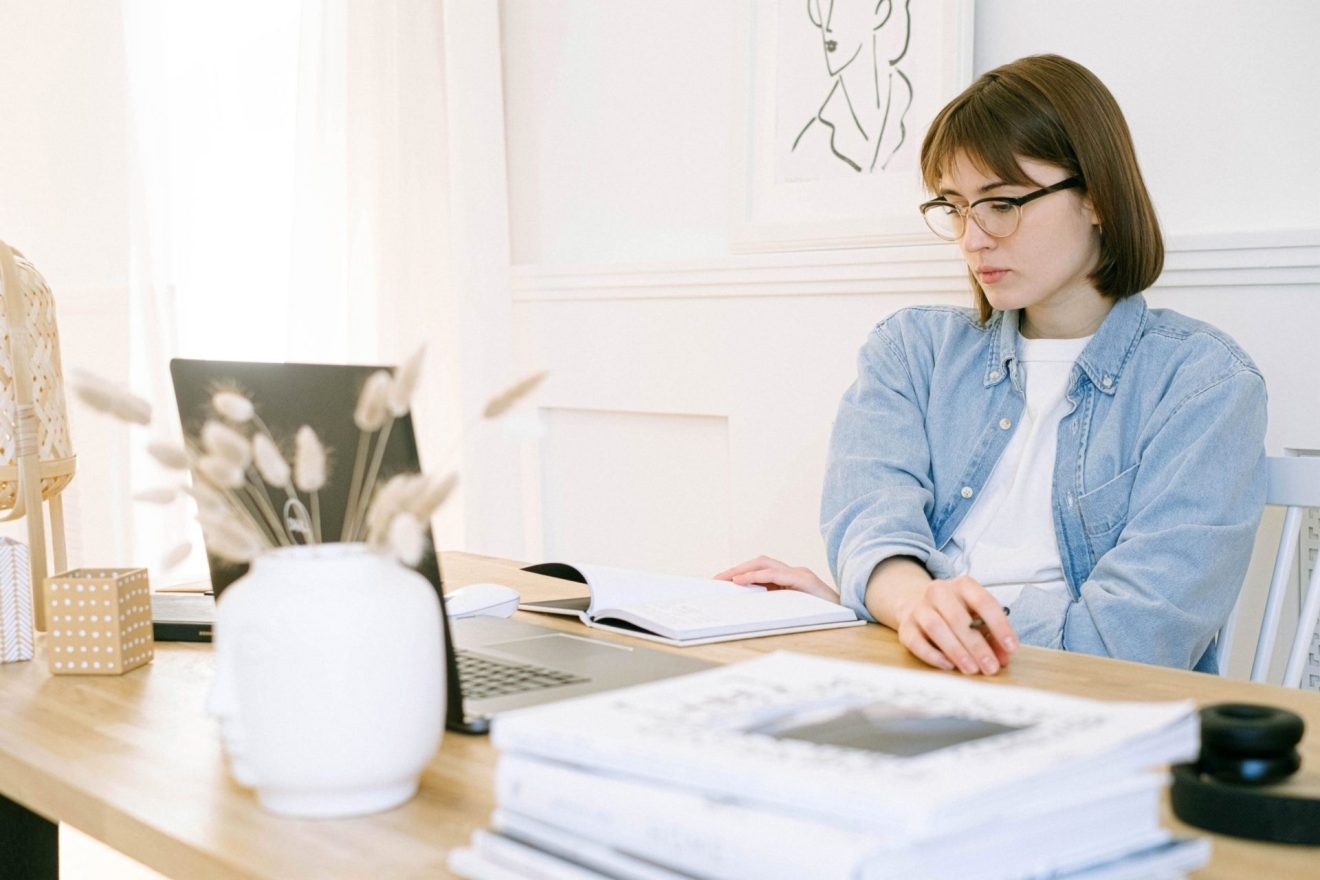Woman sitting at desk with notebook