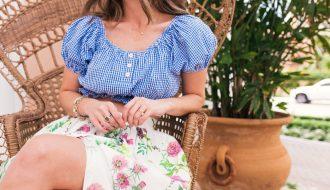 Woman sitting outside wearing a skirt