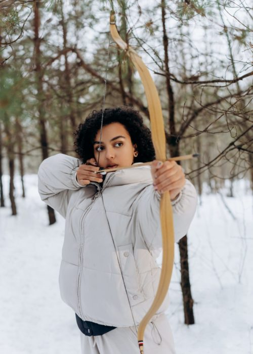 woman with bow and arrow in winter