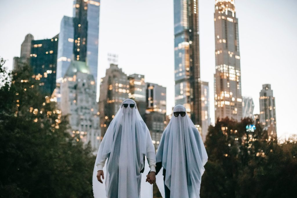 Couple dressed as ghosts on Halloween