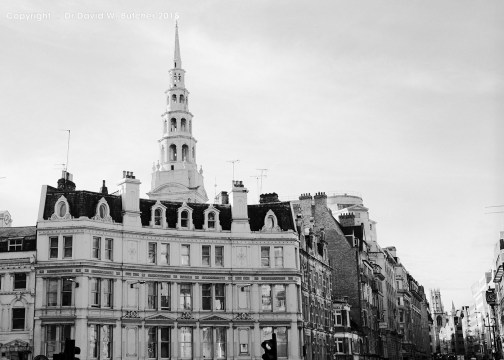 Ludgate Circus near Fleet Street and spire of St Bride's Church in London