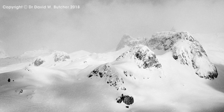 Mountains and mist at the Ischgl ski area in Austria by Dave Butcher