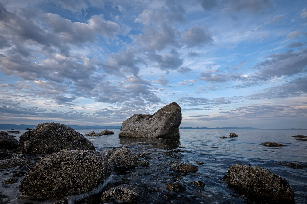 Several rocks in the rising tide at Point Holmes, BC.