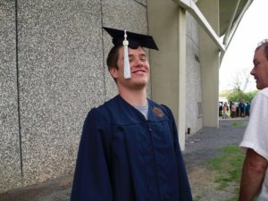 Scott graduating from Syracuse.