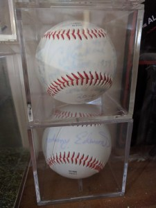 The top baseball was signed by Carl Ersine. The bottom by Johnny Edwards. The Leather did not hold the ink at all. Avoid this type of ball.
