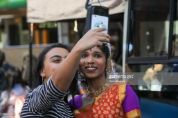 AUCKLAND, NEW ZEALAND - OCTOBER 20: People take selfies during the 17th Auckland Diwali Festival on October 20, 2018 in Auckland, New Zealand. Auckland Diwali Festival is one of Auckland's biggest and most colourful cultural festival, celebrating traditional and contemporary Indian culture. (Photo by Dave Simpson/WireImage)