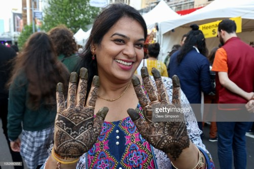 AUCKLAND, NEW ZEALAND - OCTOBER 21: A lady shows her henna tattoos during the 17th Auckland Diwali Festival on October 21, 2018 in Auckland, New Zealand. Auckland Diwali Festival is one of Auckland's biggest and most colourful cultural festival, celebrating traditional and contemporary Indian culture. (Photo by Dave Simpson/WireImage)