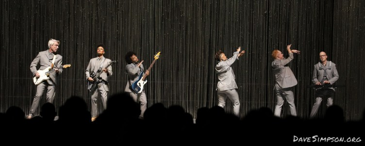 AUCKLAND, NEW ZEALAND - NOVEMBER 17: David Byrne, Angie Swan (guitar), Bobby Wooten (bass guitar), Simi Stone (backing vocals), Chris Giarmo (backing vocals) and Karl Mansfield (keyboard) perform on stage as part of David Byrne's American Utopia World Tour at Spark Arena on November 17, 2018 in Auckland, New Zealand. (Photo by Dave Simpson/WireImage)