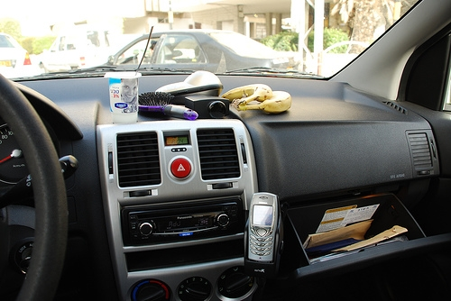 Top row: yogurt drink, hairbrush, electric shaver, Polo cologne, bananas; bottom: CD playing, cell phone