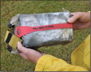 A fire shelter in its bag