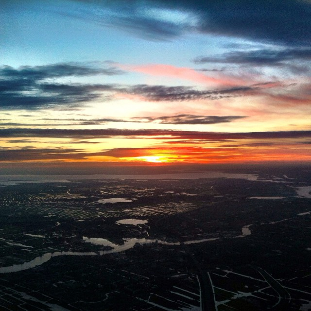 Sunrise over the Netherlands as we fly into Amsterdam from New Delhi. Inching closer home!