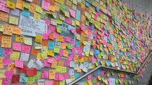 "Hong Kong's ""democracy wall"" where people have written their messages. The stairs in the picture leads up to one of the entrances of the Government HQ."