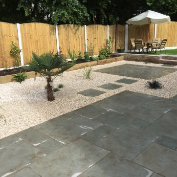 Blue limestone interspersed with cream Cotswold gravel