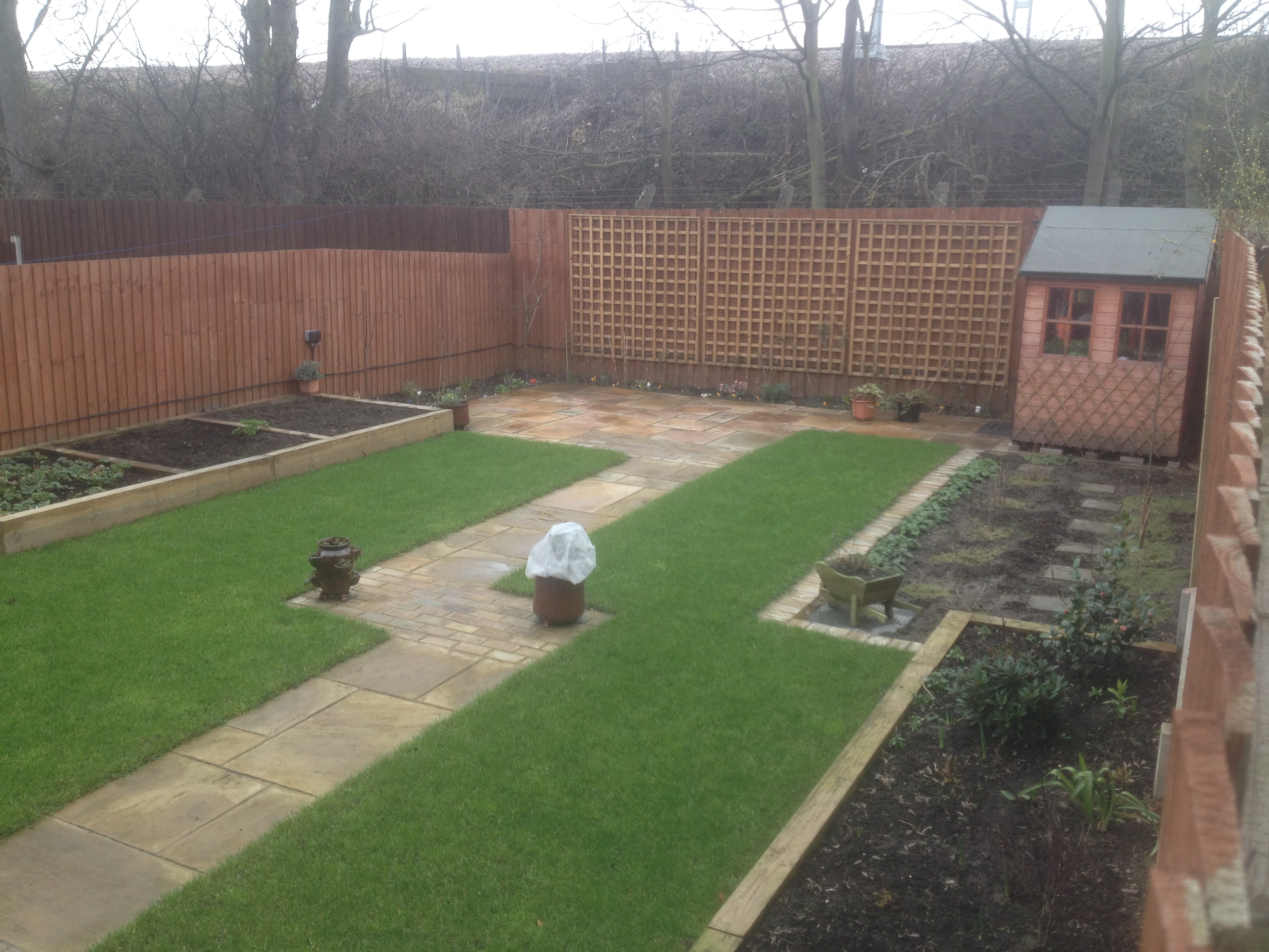 Indian sandstone paving and raised beds