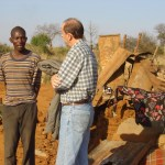 Discussing with a resident of Killarney whose home had been destroyed in Murambatsvina June 2005