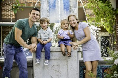 Melody's family posing by the water fountain