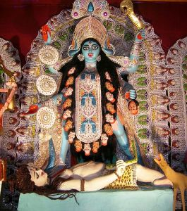 """A goddess and her lover (from the Kali Puja festival in Calcutta). """" ... had me dragged out of the house and essentially beaten until I realized that she was real and I was not dreaming."""" (Source: Wikimedia.)"""