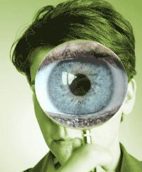 Large eye through a magnifying glass