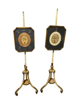 Pair of George III Painted and Giltwood Pole Screens.