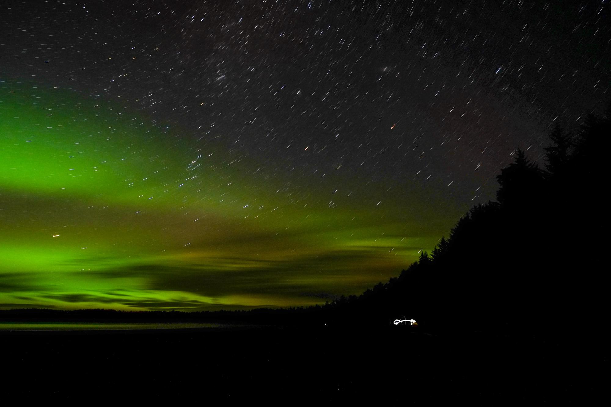 The Northern Lights shine above Cape Scott campsite.