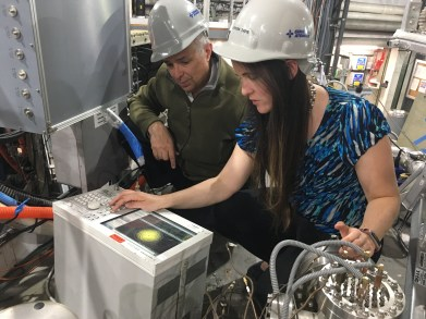 Kathreen Thome, Ph.D. and Robert Pinsker, Ph.D. calibrate the spectral response of high frequency magnetic probes on the DIII-D tokamak.