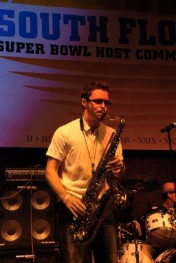 David Turner playing saxophone at a Super Bowl event in South Florida.