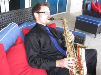David Turner, saxophonist living in Sarasota, sits outdoors at the Ritz Carlton in Fort Lauderdale, FL.