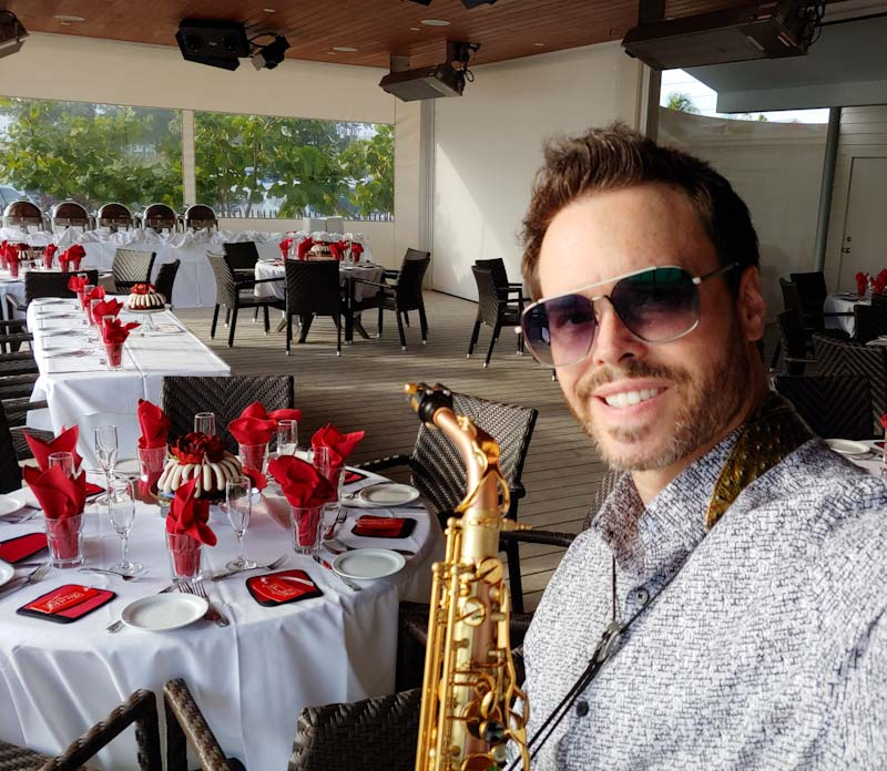 Sarasota and Bradenton area sax player David Turner, also a DJ, is seen at a Beach House wedding on Anna Maria Island, FL