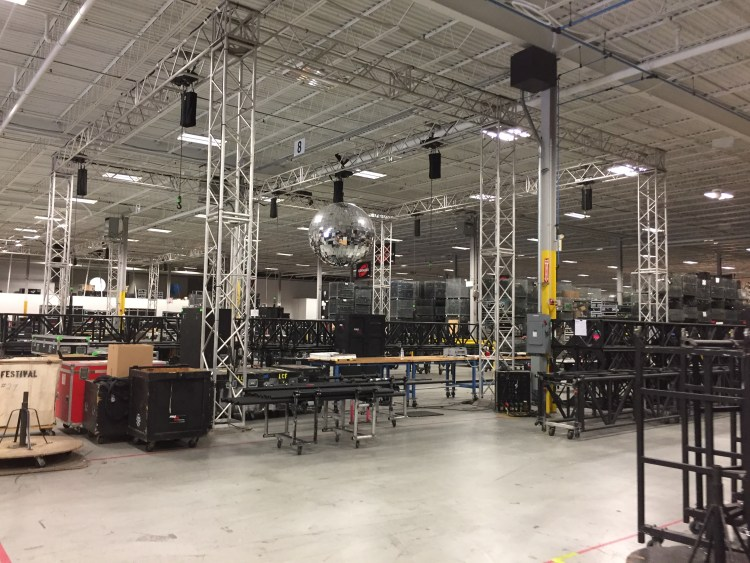 Beginning stages of prep. Note the truss laid out and some instrument cases around. Eventually units will likely be hung inside the truss and the truss sent off.
