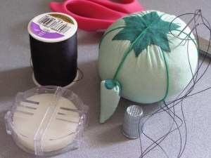 Essential sewing tools: Pin cushion, needles, pins, thimble, thread, bee's wax, sewing shears