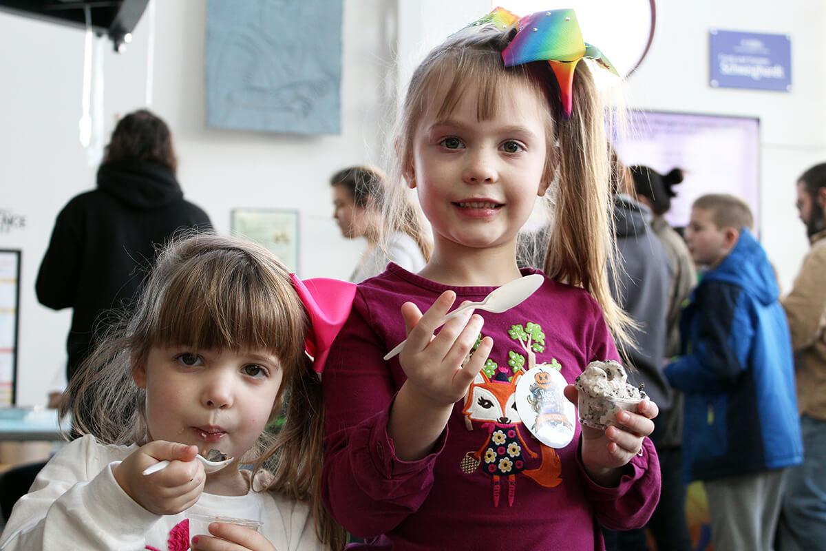 Two girls eating ice cream