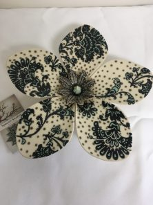 Ceramic flower wall hanging featuring a paisley print by Adam Spector